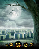 Halloween design - Spooky tree. Horror background with cemetery, and full moon. Space for your holiday text Stock Photos