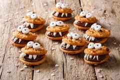 Halloween Dessert: funny monsters from cookies close-up. horizon. Halloween Dessert: funny monsters from cookies close-up on a table. horizontal stock photography