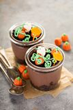 Halloween dessert in a jar, chocolate pudding. With pumpkin patch made with candy Stock Photos