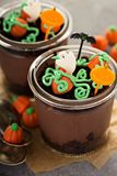 Halloween dessert in a jar, chocolate pudding. With pumpkin patch made with candy Royalty Free Stock Photos