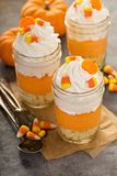 Halloween dessert in a jar layered candy corn parfait. With cream cheese Royalty Free Stock Image