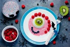 Halloween dessert recipe idea scary fun and tasty one-eyed monst Stock Photo