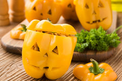 Halloween dinner- stuffed peppers with shredded chicken, and Mexican rice royalty free stock image