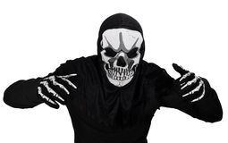 Halloween disguise. A man wearing a skull mask royalty free stock images