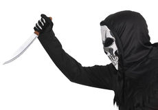 Halloween disguise. A man wearing a skull mask waving a knife royalty free stock photo