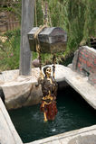 Halloween at Disneyland. Skeleton of a pirate holding to a chest, over the water at Disneyland Stock Photos