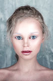 Halloween doll face beautiful girl with perfect make up and hair Stock Photo