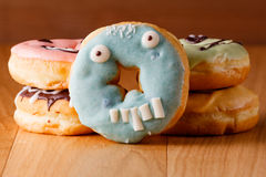 Halloween donuts on wooden table Stock Images