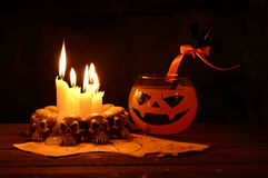 Halloween drink with evil candles Royalty Free Stock Photos