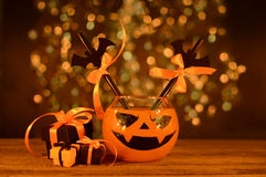 Halloween drink with gifts in candlelight Royalty Free Stock Image