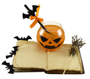 Halloween drink with magic book Royalty Free Stock Photo