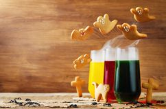 Halloween drinks with flying cookies. On a wood background. toning. selective focus Royalty Free Stock Images