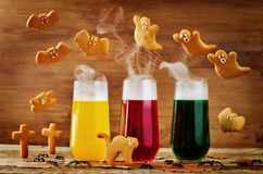 Halloween drinks with flying cookies. On a wood background. toning. selective focus Stock Photography