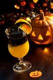 Halloween drinks - Rotten Pumpkin Cocktail. Closeup of Rotten Pumpkin Cocktail, black vodka, orange juice - Halloween drinks series Royalty Free Stock Image