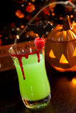 Halloween drinks - Vampire's Kiss Cocktail. Closeup of Vampire's Kiss Cocktail, rum, melon liqueur, soda and touch of tabasco, garnished with fresh raspberry stock photos