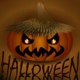 Halloween evil pumpkin in straw hat.  Royalty Free Stock Image
