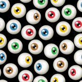 Halloween Eyeball Background. A Halloween themed background depicting different colored eyeballs. Seamlessly repeatable Stock Photography