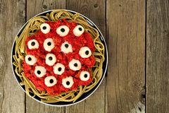 Halloween eyeball pasta, above view over old wood Royalty Free Stock Photography