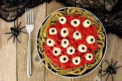 Halloween eyeball pasta with tomato meat sauce, overhead scene Royalty Free Stock Photos