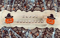 Halloween festive background. Happy Halloween letters and Halloween decorations on the wooden background stock photos