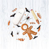 Halloween festive background with treats. Vector illustration with cookies in form of skeleton gingerbread man. Top view on spiders, paper bats and confetti on Stock Images