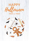 Halloween festive poster with treats. Vector illustration with cookies in form of skeleton gingerbread man. Top view on spiders, paper bats and confetti on Royalty Free Stock Photos
