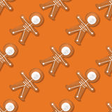 Halloween festive seamless pattern with cookies. Vector illustration with cookies in form of skeleton gingerbread man. Top view on treats on orange backdrop Stock Images