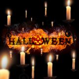 Halloween, Fire Text and pumpkin on black background. Halloween, Fire Text, pumpkin and candles on black background Stock Photo