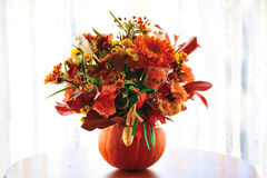 Flowers on pumpkin Stock Photography