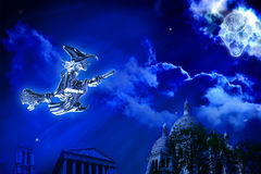 Halloween Flying Witch and Floating Skull Royalty Free Stock Photo
