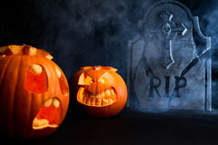 Halloween foggy night with pumpkins and tombstone Royalty Free Stock Photos