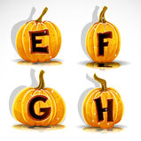 Halloween font cut out pumpkin letter E,F,G,H Royalty Free Stock Images