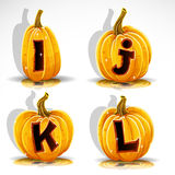 Halloween font cut out pumpkin letter I,J,K,L Stock Photo