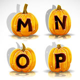Halloween font cut out pumpkin letter M,N,O,P Stock Images