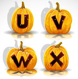 Halloween font cut out pumpkin letter U,V,W,X Stock Photo