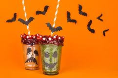 Halloween food. Fun monsters smoothie on orange background. Royalty Free Stock Image