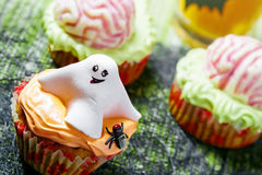 Halloween food. Halloween ghost and brain cakes, dessert Royalty Free Stock Images