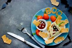 Halloween food idea - pepper shaped mummy with bat tortilla cris Stock Photos