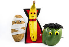 Halloween food monsters. A trio of food dressed in Halloween costumes Stock Photo