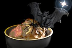 Halloween food. Spooky glowing lava sponge with fun novelty spid. Er and vampire bat. Creepy night image of trick or treat snack Royalty Free Stock Photography