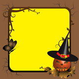 Halloween frame. Abstract colorful background with Halloween pumpkin with a witch hat standing in a corner of a frame with tree branches. Halloween design Royalty Free Stock Photos