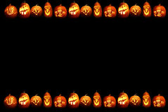 Halloween frame. Frame composed of Halloween pumpkins on black Royalty Free Stock Image