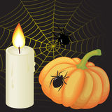 Halloween frame. With a pumpkin , a candle, spiders and a web Stock Photos