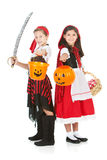 Halloween: Friends Ready for Trick Or Treat. Halloween series with cute children dressed as Dracula, a pirate, and Little Red Riding Hood.  Isolated on white Royalty Free Stock Photo