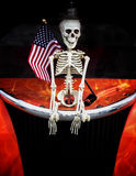 Halloween Fright. A skeleton  with an American flag Stock Photography