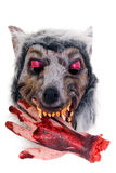 Halloween, fun and creepy. Werewolf with bloody hand on white background Stock Photo