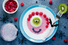 Halloween funny dessert recipe -scary eye semisphere jelly with Stock Photography