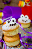Halloween funny monster muffins with chocolate eyes for treat ki Royalty Free Stock Photo