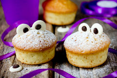 Halloween funny monster muffins with chocolate eyes for treat ki Stock Image