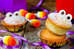 Halloween funny monster muffins with chocolate eyes for treat ki Royalty Free Stock Images